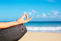 Young woman practicing morning meditation yoga fitness in nature at the beach Stock Photos