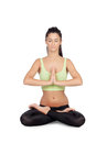Young woman practicing yoga in the lotus position isolated on white background Stock Photography
