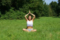 Young woman practicing yoga meditation outdoors Royalty Free Stock Photo