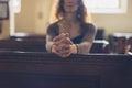 Young Woman Praying In Church