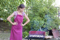 Young woman preparing barbecue Royalty Free Stock Photo