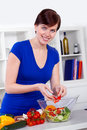 Young woman preparing healthy salad her modern kitchen Stock Photography