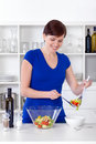 Young woman preparing healthy salad her modern kitchen Stock Image