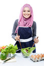 Young woman preparing making salad Royalty Free Stock Photo