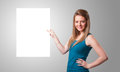 Young woman presenting white paper copy space Stock Photo