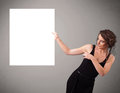 Young woman presenting white paper copy space pretty Stock Photography