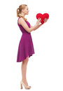 Young woman in purple dress and high heels beauty fashion love happy people concept red heart Royalty Free Stock Photography