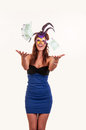 Young woman in purple mysterious venetian mask throw money masquerade Royalty Free Stock Image