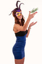 Young woman in purple mysterious venetian mask throw money masquerade Stock Photo