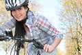 Young woman pushing a bicycle Royalty Free Stock Photo