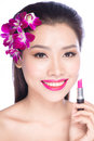 Young woman putting lipstick on lips Royalty Free Stock Photo