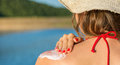 Young woman putting sun lotion on summer vacation Royalty Free Stock Photo
