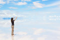Young woman with raised arms standing on salar de uyuni hands Royalty Free Stock Photo