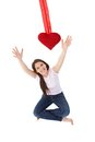 Young woman reaching out for red heart smiling Stock Photos