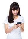 Young woman read the message on cellphone Royalty Free Stock Photo