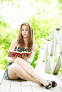 Young woman  reading  a book Royalty Free Stock Photography