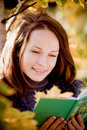 Young woman reading book in autumn Royalty Free Stock Image