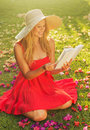 Young Woman Reading Book Outside Stock Photography