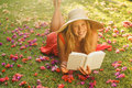 Young Woman Reading Book Outside Royalty Free Stock Images