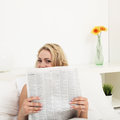 Young woman reading morning newspaper Royalty Free Stock Photography