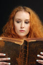 Young woman reading an old bible Royalty Free Stock Photography