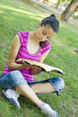 Young woman reading outdoor Stock Photography