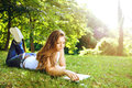 Young woman reading in park Royalty Free Stock Photo
