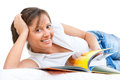 Young woman reading travel magazine on the sofa or in bed isolated on white background inspector note i am the author of the Stock Photography