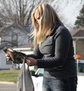 Young woman reads charred document after fire Royalty Free Stock Photography