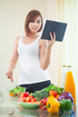 Young woman reads cookbook asian for recipe at kitchen Stock Photography
