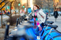 Young woman ready to rent a bike in new york beautiful city usa Royalty Free Stock Photography