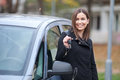 Young woman ready to travel beautiful standing by the car with car keys Royalty Free Stock Image