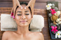 Young woman receiving facial massage with closed eyes in a spa salon Royalty Free Stock Photos