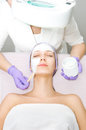 Young woman receiving facial treatment in salon Stock Images