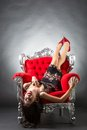 Young woman in a red chair retro style Royalty Free Stock Photo