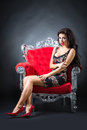 Young woman in a red chair retro style Stock Photos