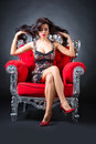 Young woman in a red chair retro style Stock Images
