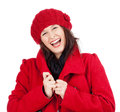 Young woman in red coat and cap laughing isolated on white Stock Image