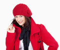 Young woman in red coat and cap smiling isolated on white Royalty Free Stock Images