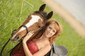 Young woman in a red dress on a horse Royalty Free Stock Photos