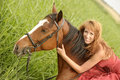 Young woman in a red dress on a horse Royalty Free Stock Photo