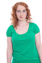 Young woman with red hair and skeptical look isolated on white Royalty Free Stock Image