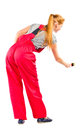 Young woman in red overalls with painting tools Royalty Free Stock Image