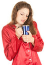 Young woman in red pajamas with big blue cup Stock Image