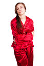 Young woman in red pyjamas with stomach ache white background Stock Images