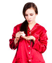 Young woman in red pyjamas taking painkiller white background Royalty Free Stock Photos