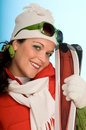Young woman with red skis Royalty Free Stock Photography