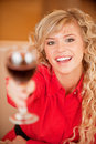 Young woman with red wine Royalty Free Stock Image