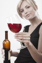 Young woman with red wine Royalty Free Stock Photos