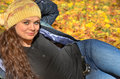 Young woman relaxing  in autumn leaves and smiling Royalty Free Stock Photos